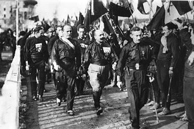 From left to right: unknown, Benito Mussolini, Cesare Maria de Vecchi and Michele Bianchi in 1922